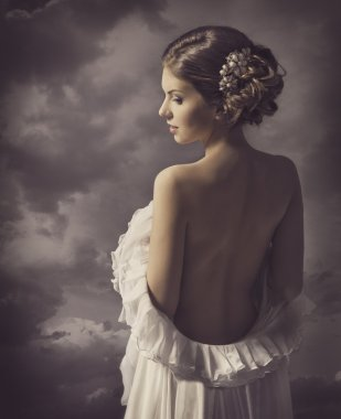 Woman fashion dress, retro hair style, naked back, historical romance portrait
