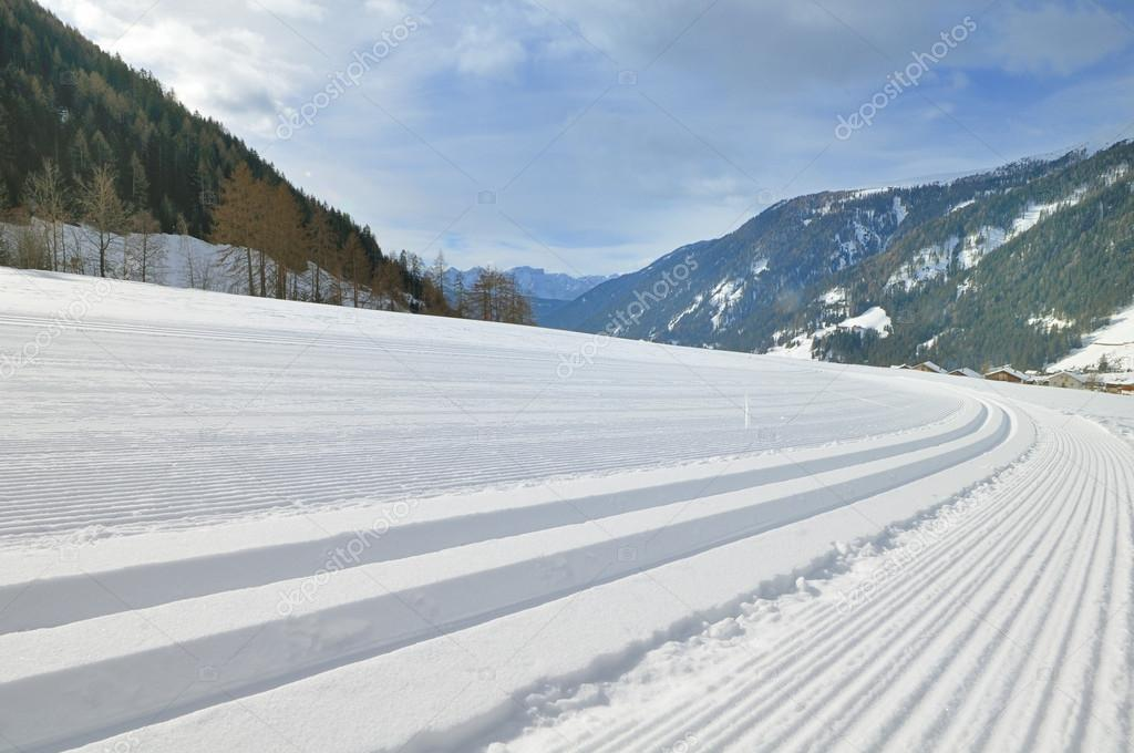 Snowy mountain landscape with cross country track