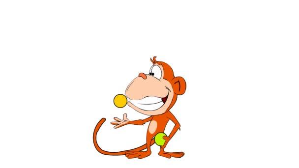 legrační opice žonglování míčky