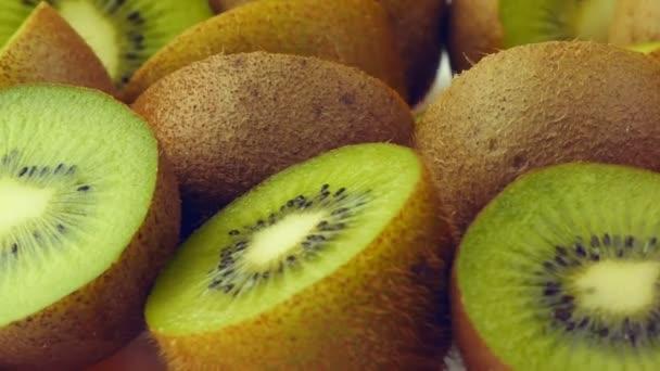 Halves an kiwi fruits closeup rotating