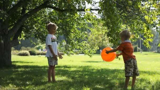 Two young boys playing with a ball