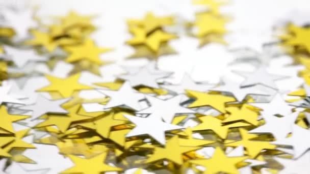 Silver and Gold confetti stars on a white background