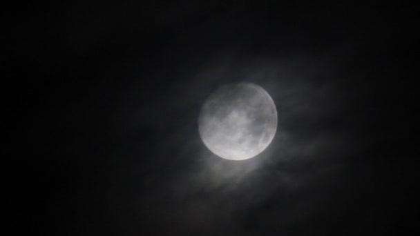 Moon through misty clouds on the sky