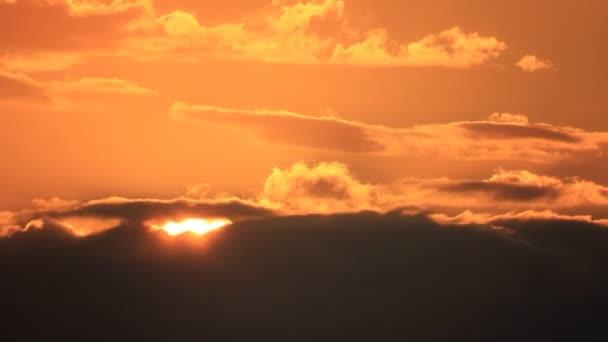 Glowing sun on darkness clouds sky