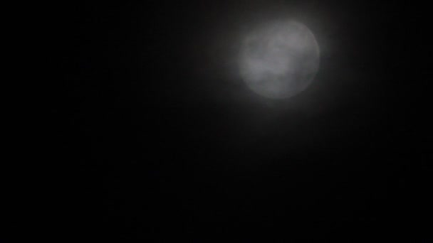 Moon through misty clouds on the sky