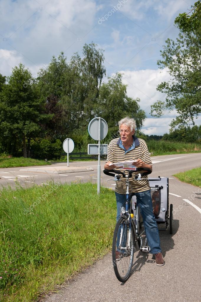 older man checking the bike map