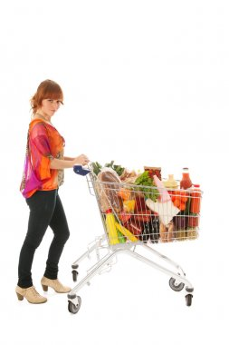 Woman with Shopping cart full dairy grocery