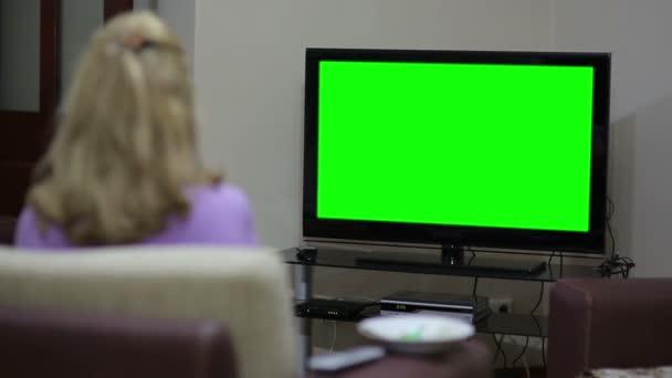 Senior woman watching TV