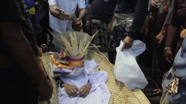 Burning dead body in balinese funeral