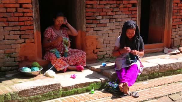 Local women knitting at street