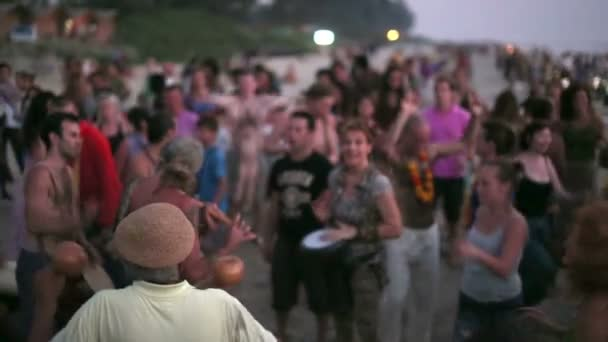 People dancing on beach