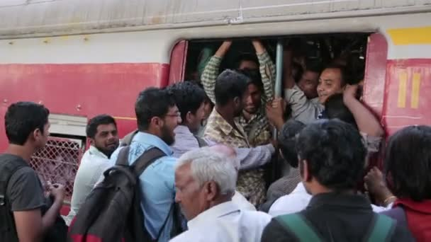 People getting on a crowded train