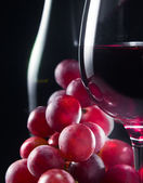 grape and glass with red wine