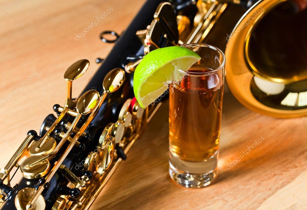 Saxophone and tequila with lime — Stock Photo © igorr1 #45588959