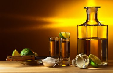 gold tequila with salt and lime