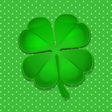 four leaf clover on green polka dot background
