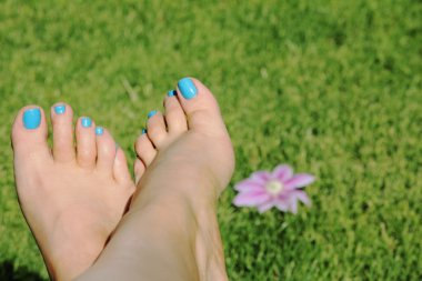 Woman foot with blue nails
