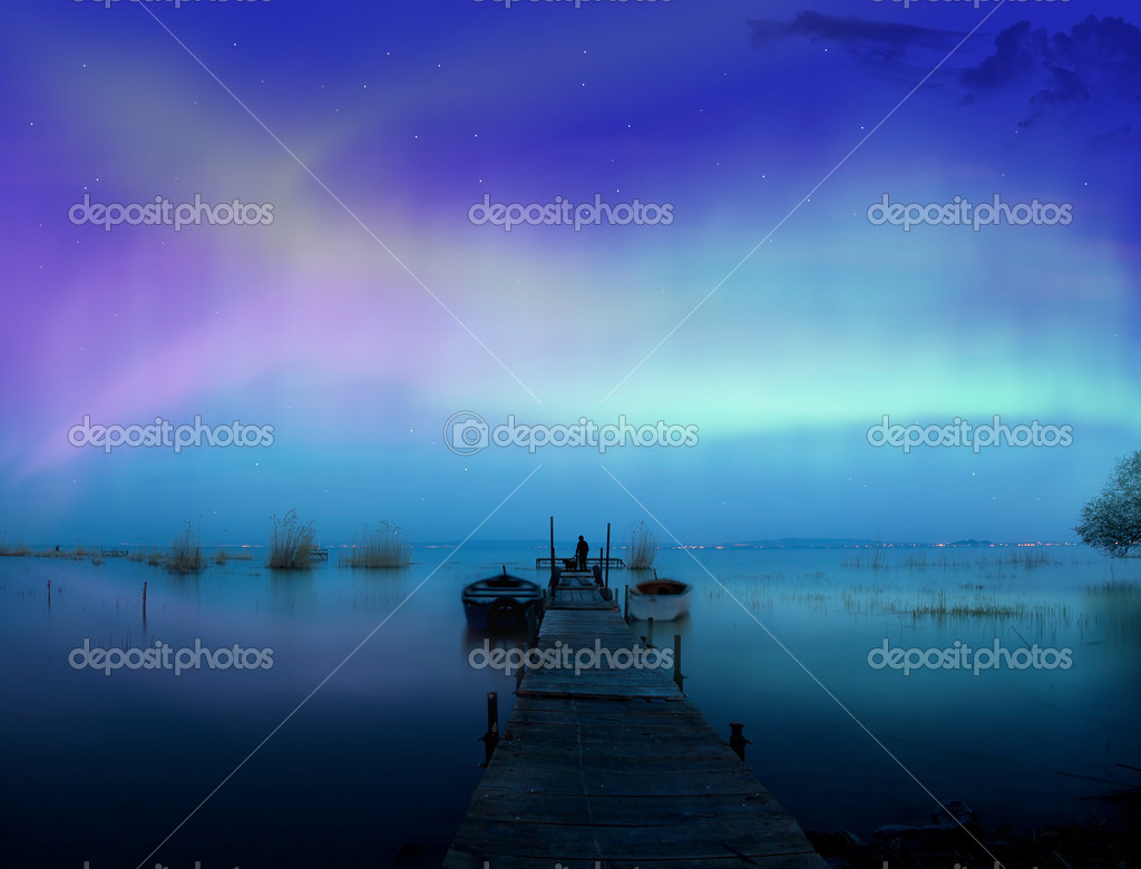 Lights above the lake,man with a dog