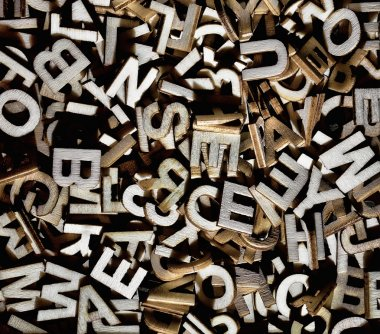 Jumbled letters made of wood close up