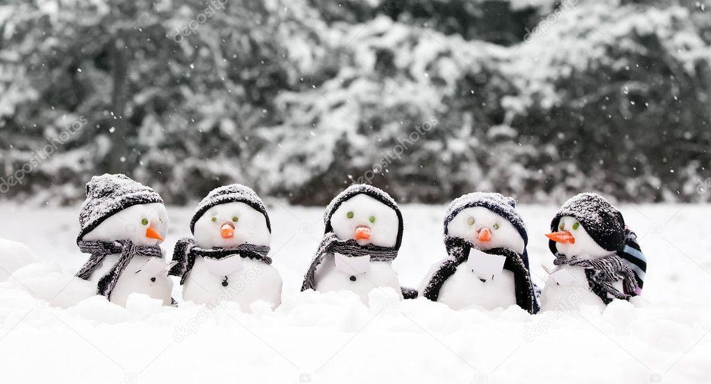 Little snowmen in a group