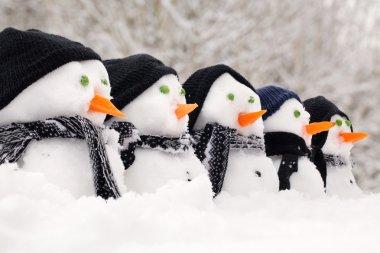 Snowmen close up in a row