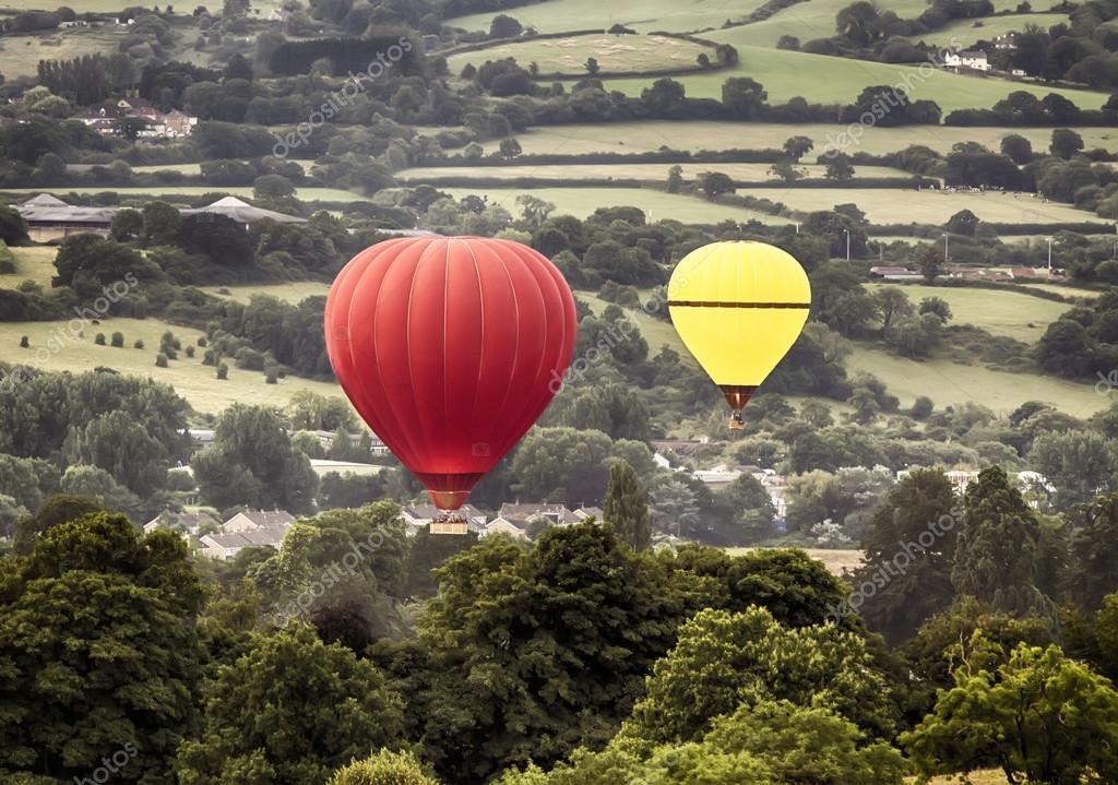 Two hot air baloons drifting