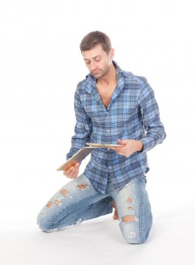 Man reading a tablet pad