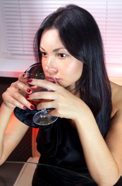 Woman with glass of brandy ll