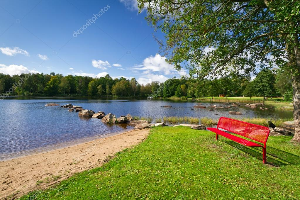 Red bench at the lake in Sweden