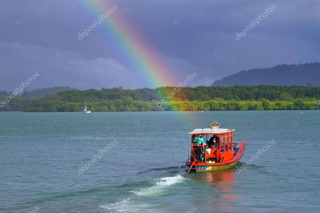 Rainbow and boat on the river in Thailand