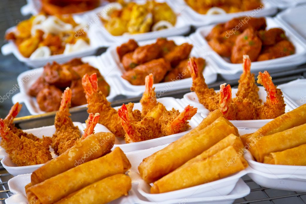 Deep fried prawns and spring rolls on the market