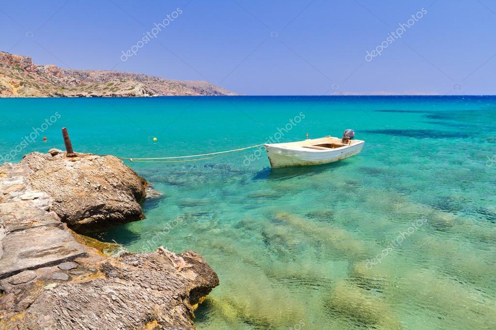 Boat on the blue lagoon of Vai beach