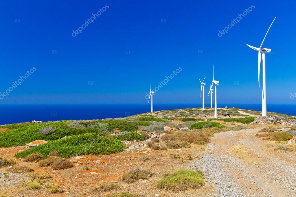 Wind turbines field over blue sky on Crete