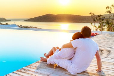 Couple in hug watching sunrise