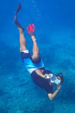 Man with video camera underwater in Andaman Sea