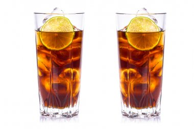 Cola in tall glasses with ice cubes and lime