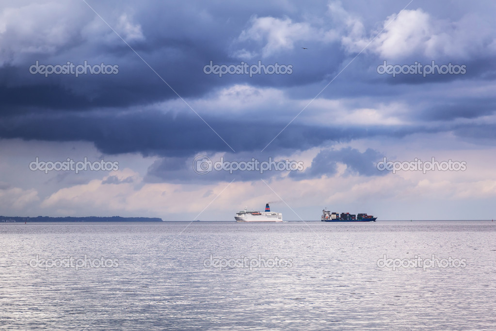 Ferry and container cargo ship on Baltic sea