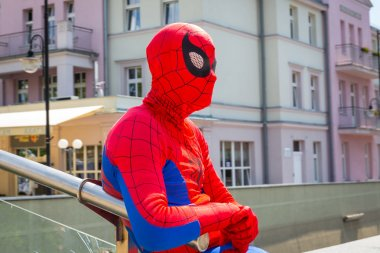 Man in spiderman outfit in main square of Sopot