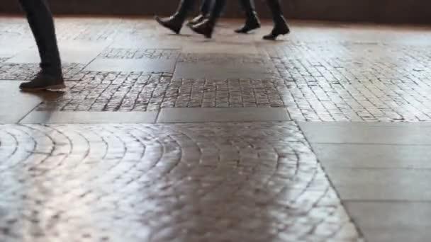 Walking feet on pavement