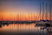Photo Marina with docked yachts at sunset