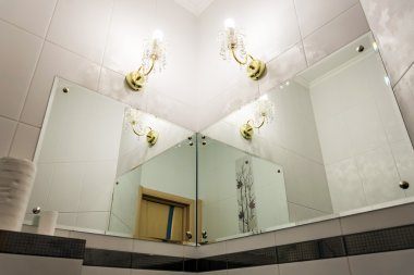 Detail of bathroom with mirrors