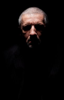 Spooky grey haired mature man
