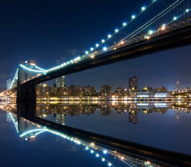 Brooklyn Bridge and Manhattan with reflections