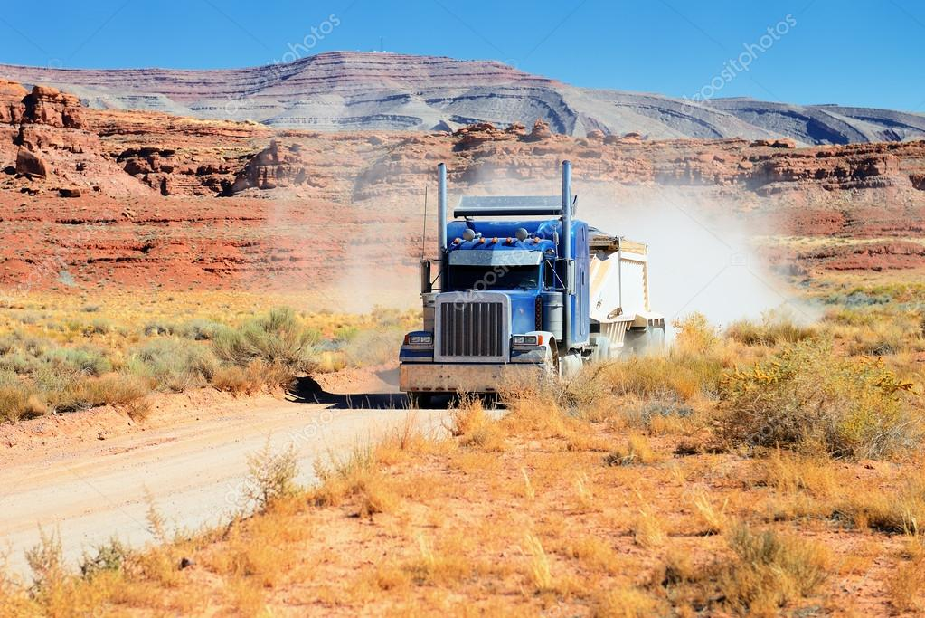 Semi-truck driving across the desert