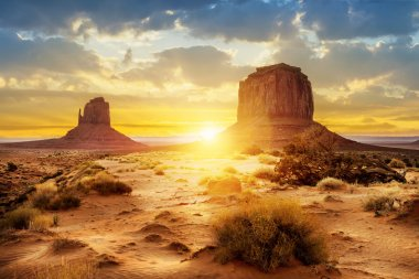 Sunset at the sisters in Monument Valley, USA stock vector