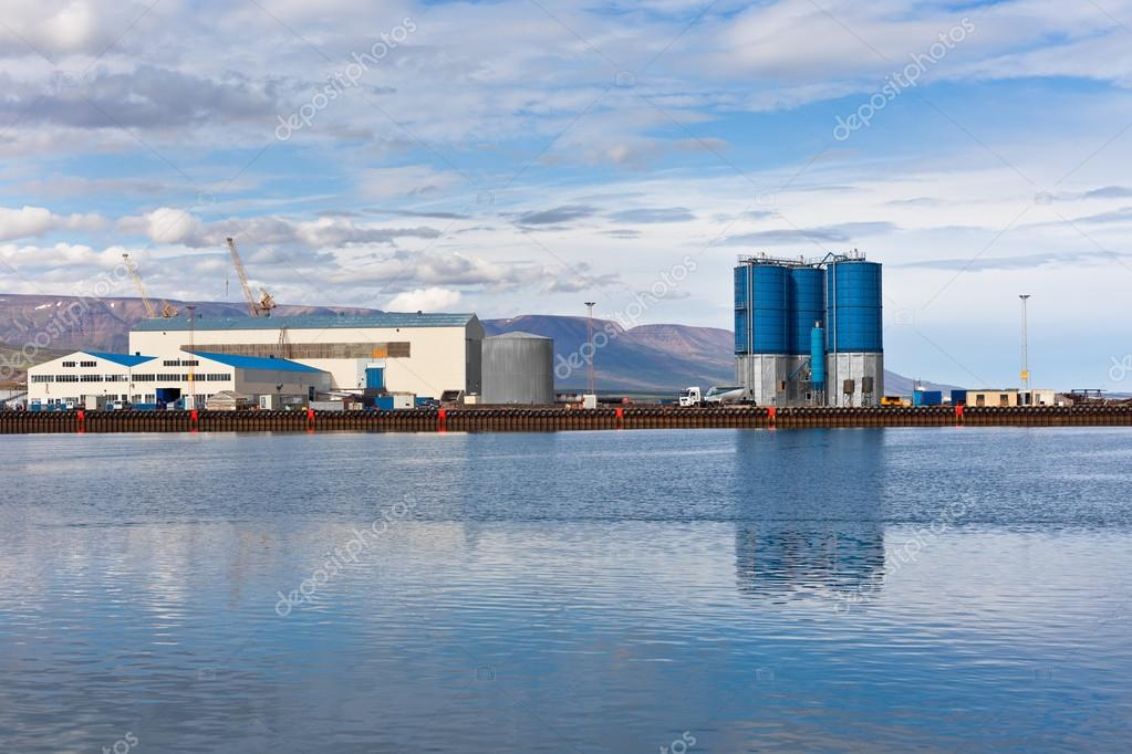Large tanks and wirehouses at sea commercial dock in North Icela ...