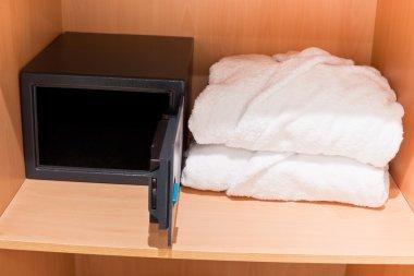 Fresh Bathrobes and Open Safe at Closet Shelf