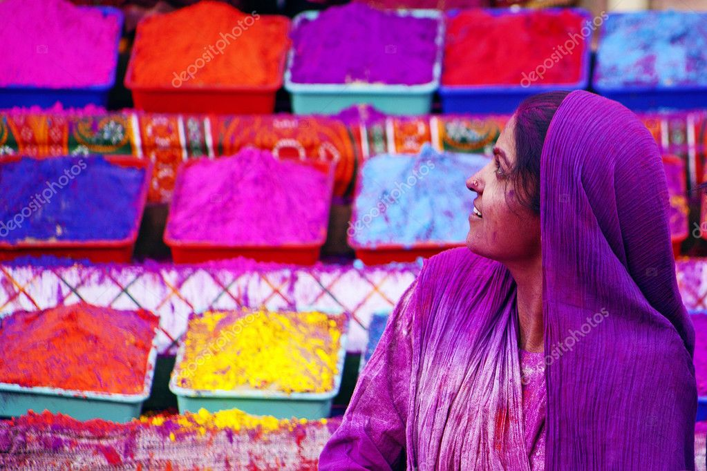 Lady in violet, covered in paint on Holi festival