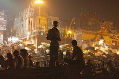 Hindu people watching religious Ganga Aarti ritual