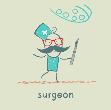 surgeon holding a scalpel
